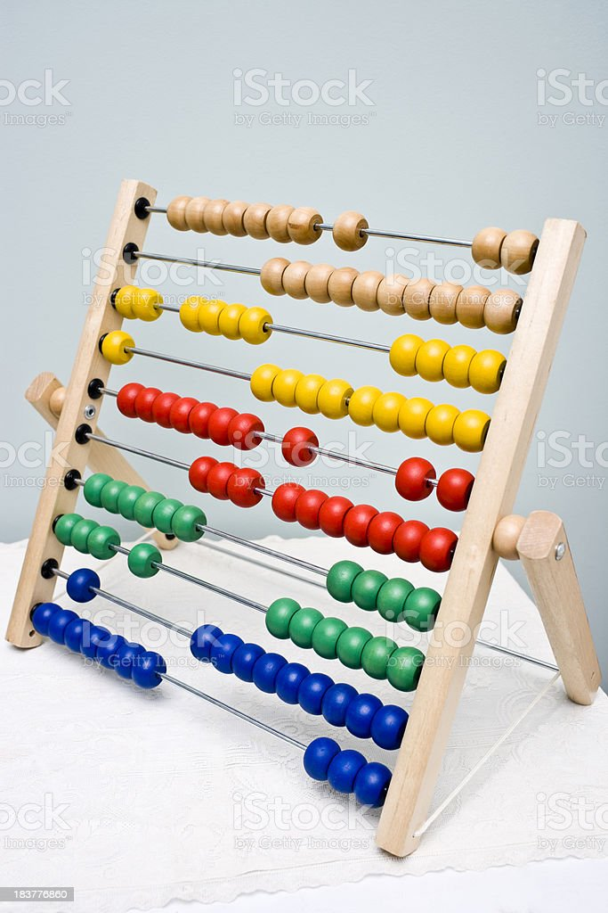 a multicolored abacus sitting on a table royalty-free stock photo