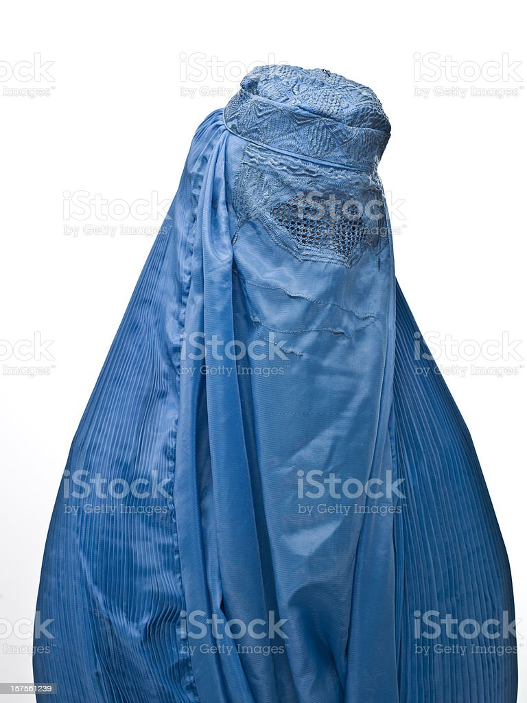 a Muslim woman wearing a blue burka stock photo