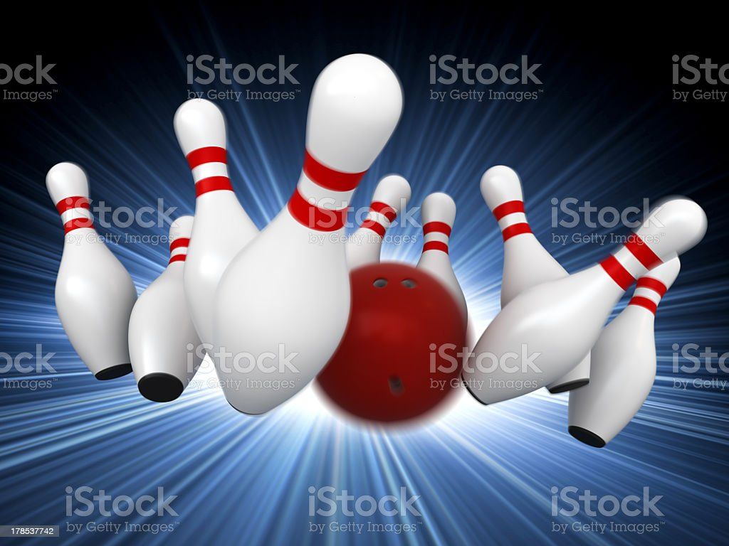 A CGI of a red bowling ball knocking down pins stock photo