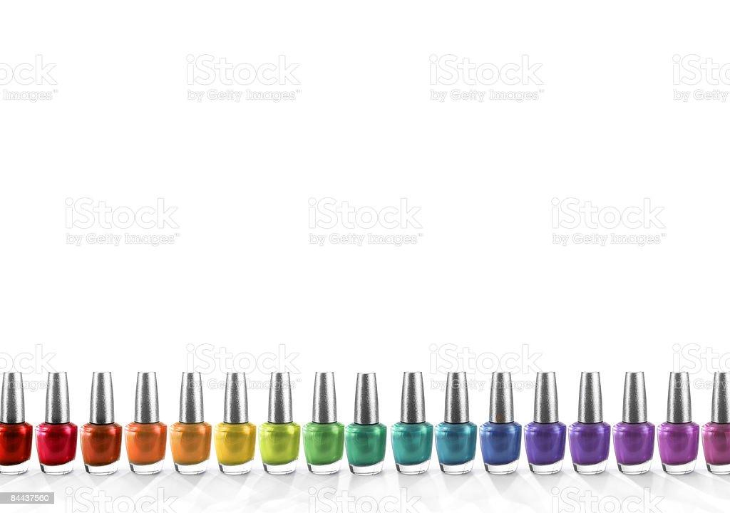 a row of nailpolish arranged in rainbow colours stock photo