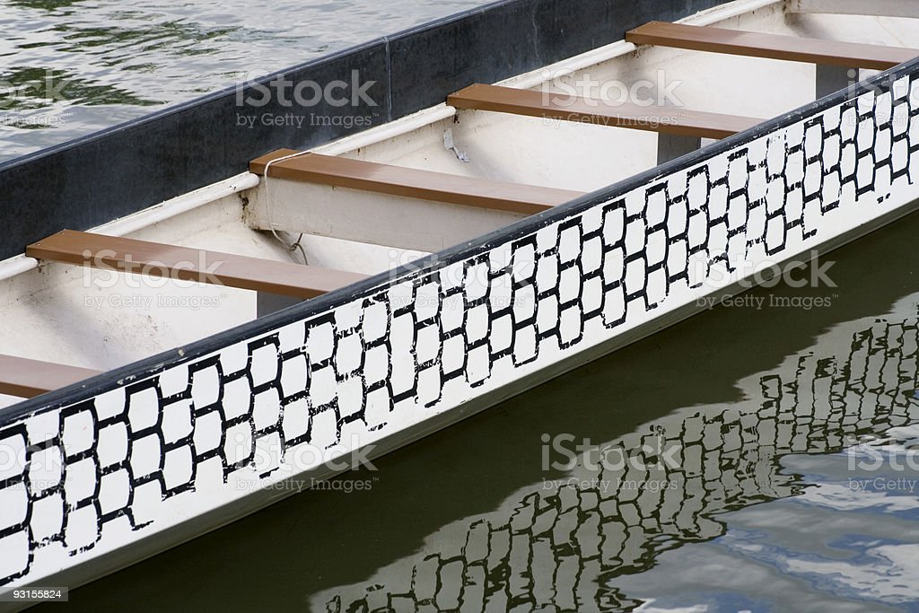 a rowboat in rippled water with reflection royalty-free stock photo