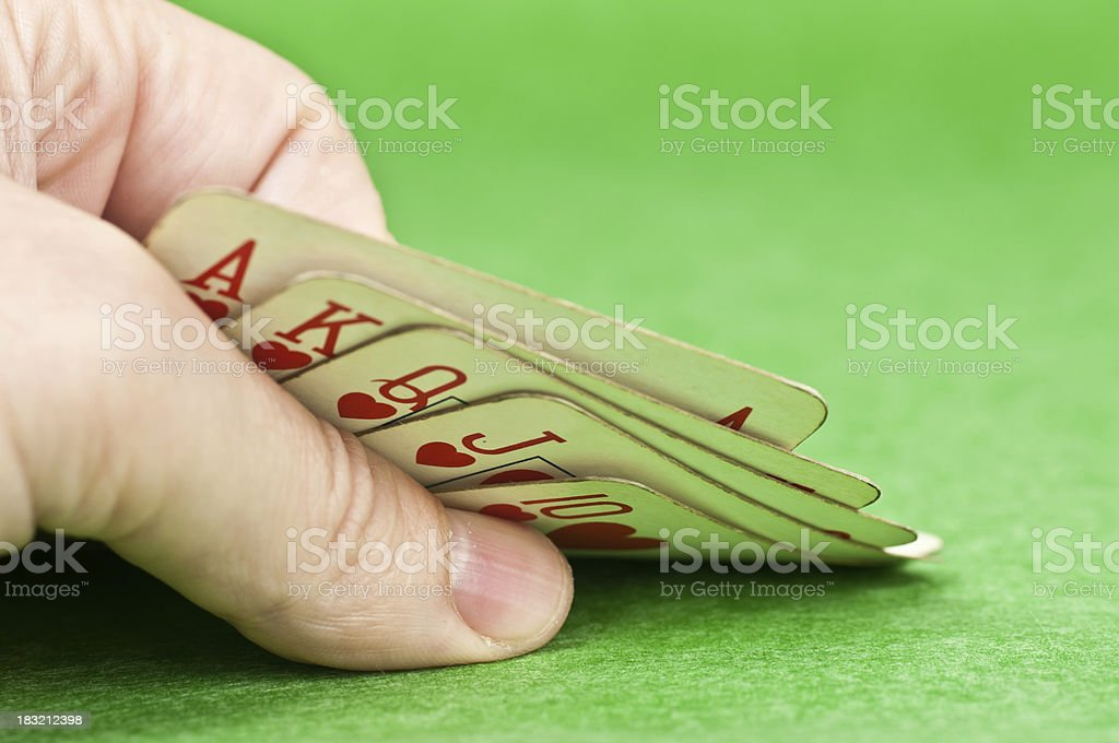 WOW. a royal flush in the hand stock photo