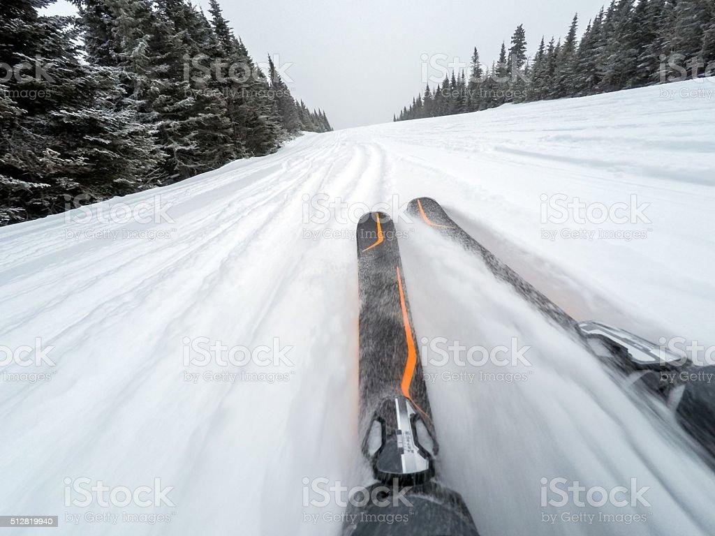 POV of a skier going down on fresh snow stock photo