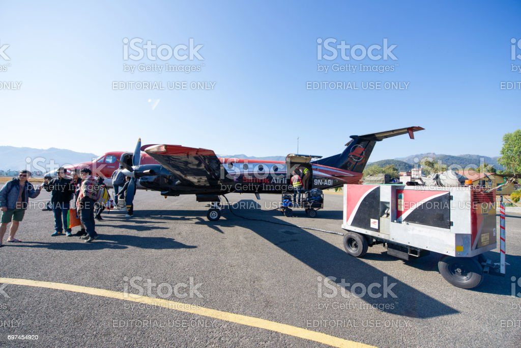 a small airplane at Pokhara airport in Nepal stock photo