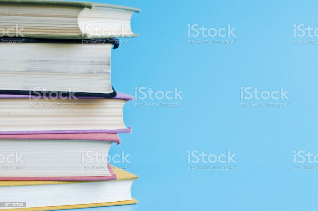 a stack of colorful books in library stock photo