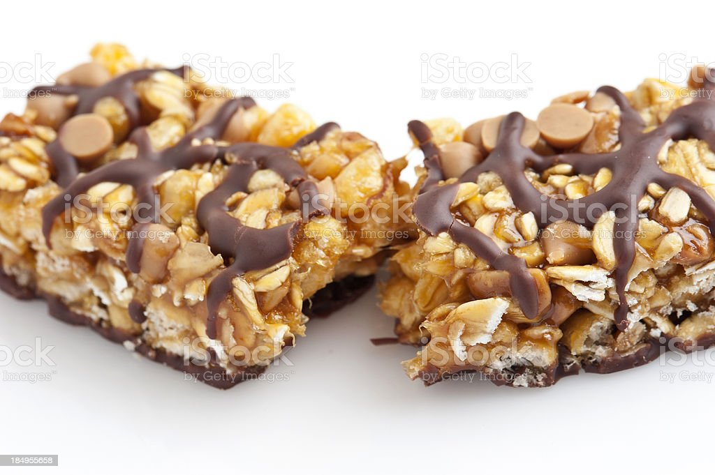 a tasty chocolate and peanut butter energy bar in half stock photo