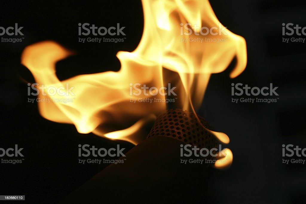 a torch with fire flame stock photo