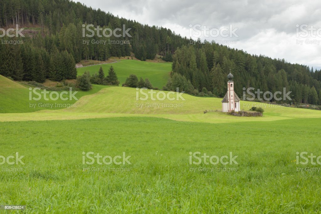 a wide green mountain pasture in Val di Funes, Italy stock photo