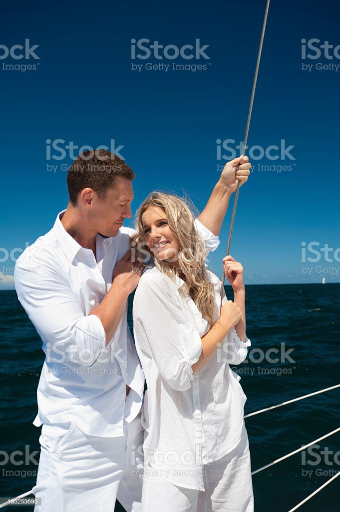 a young couple in love sailing over blue sea royalty-free stock photo