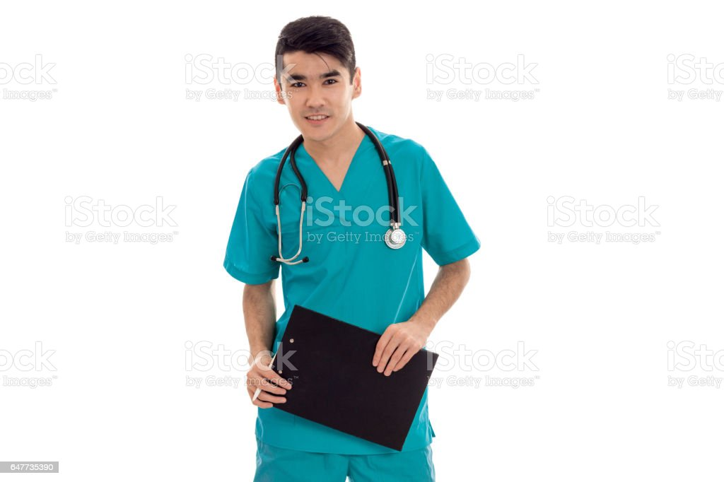 a young doctor with stethoscope looks at the camera and holding a Tablet stock photo