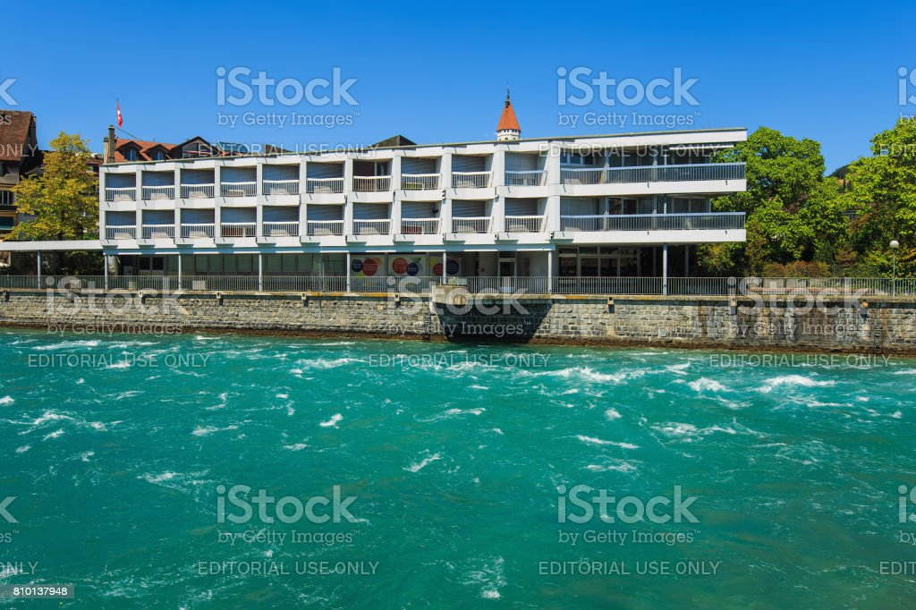 Aare river and buildings along it in the city of Thun, Switzerland stock photo