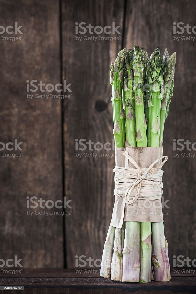 aasparagus on a wooden table stock photo