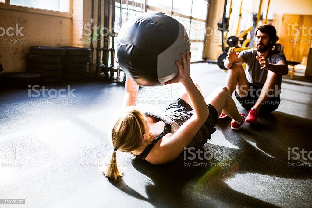 Ab Crunches with Medicine Ball stock photo
