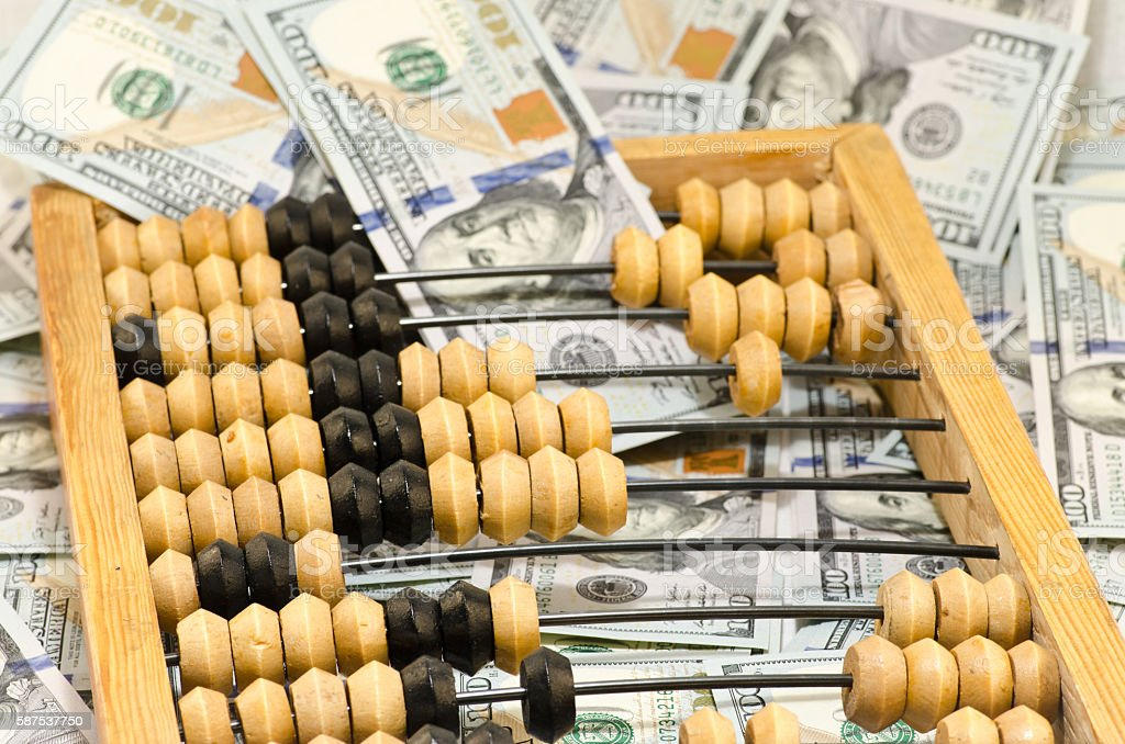 abacus and bills stock photo