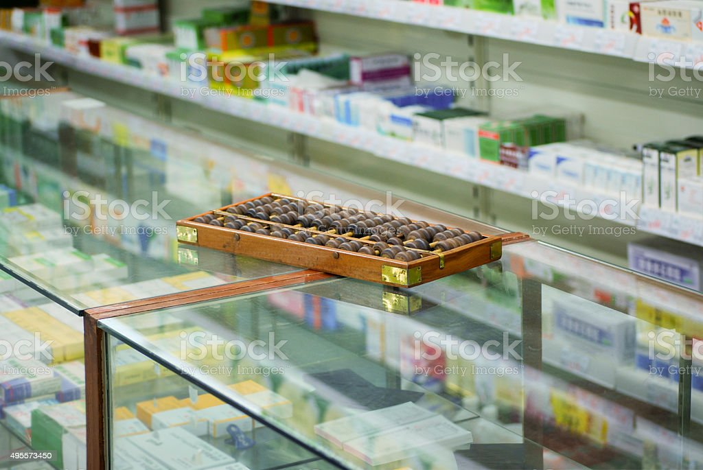 Abacus on counter at Chinese pharmacy in Beijing stock photo