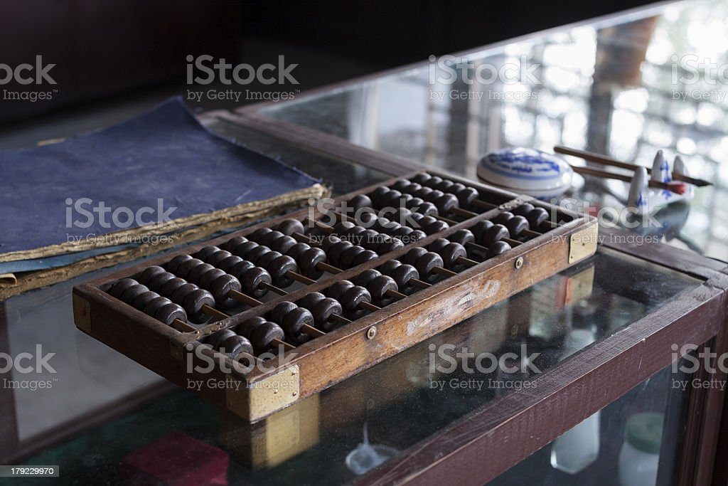 Abacus on Dusty counter stock photo