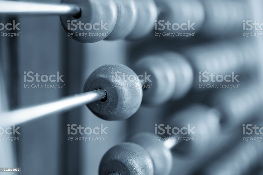 Abacus with motion blur on one bead stock photo
