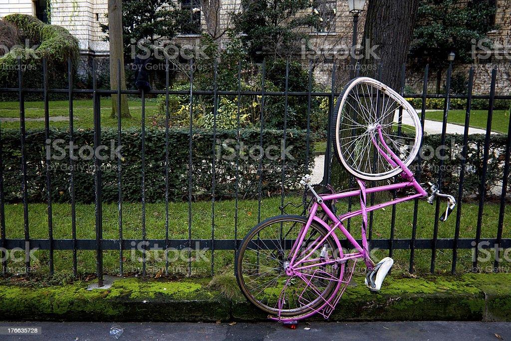 Abandon broke wheel bicycle lock on metal fence royalty-free stock photo
