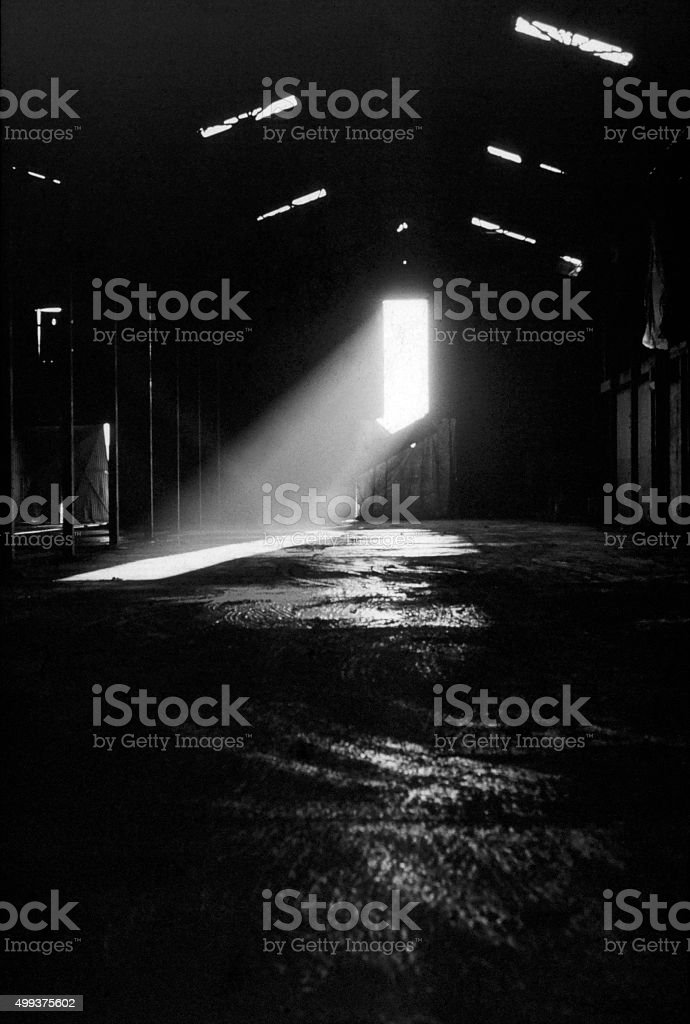 Abandon factory hall with sunlight effects stock photo