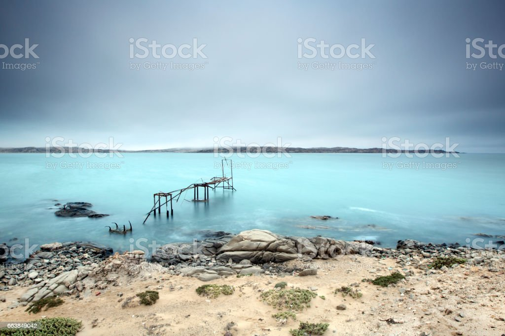 Abandon pier in the ocean stock photo