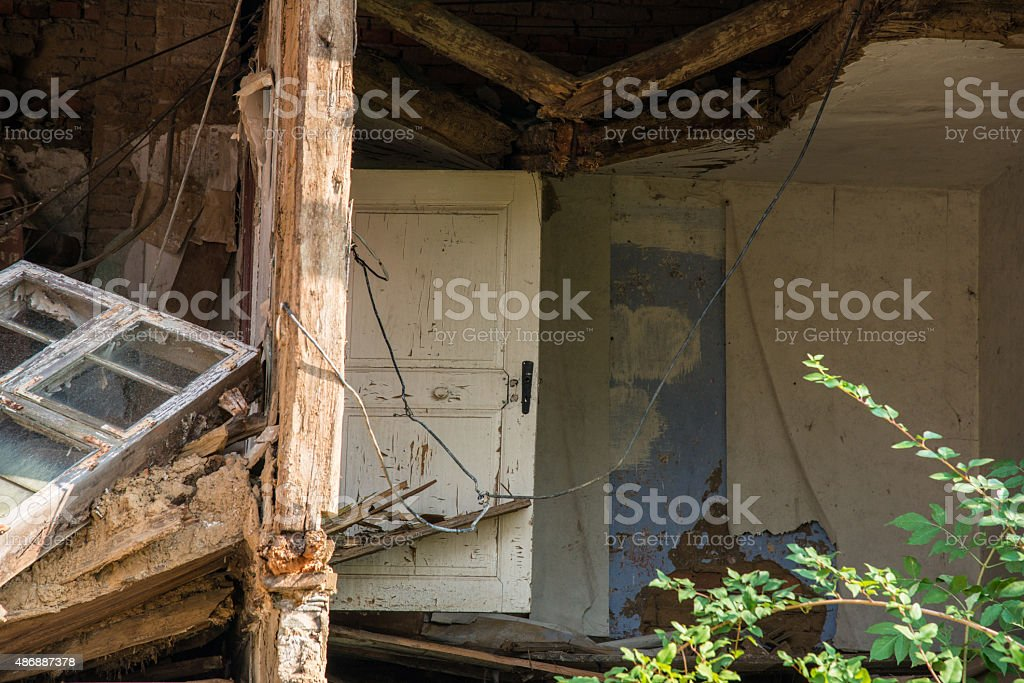 Abandoned and damaged half-timbered house with bricks stock photo