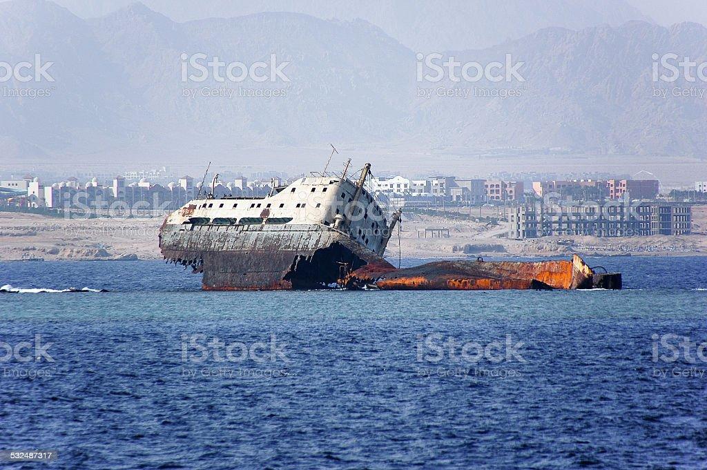 Abandoned and rusty shipwreck stock photo