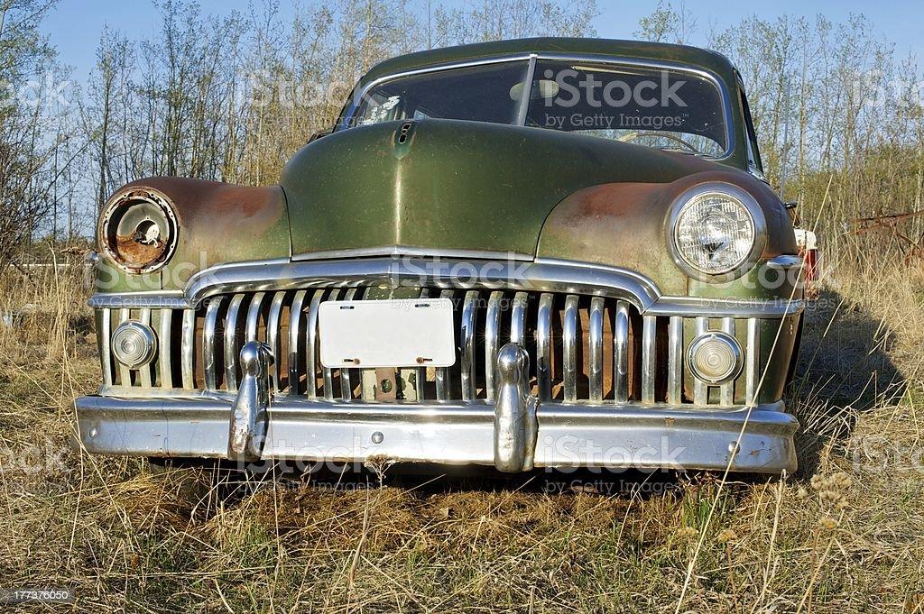 Abandoned antique car; Desoto stock photo