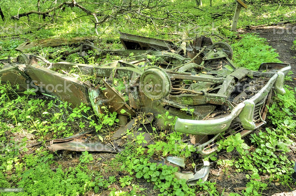 abandoned antique car in woods royalty-free stock photo