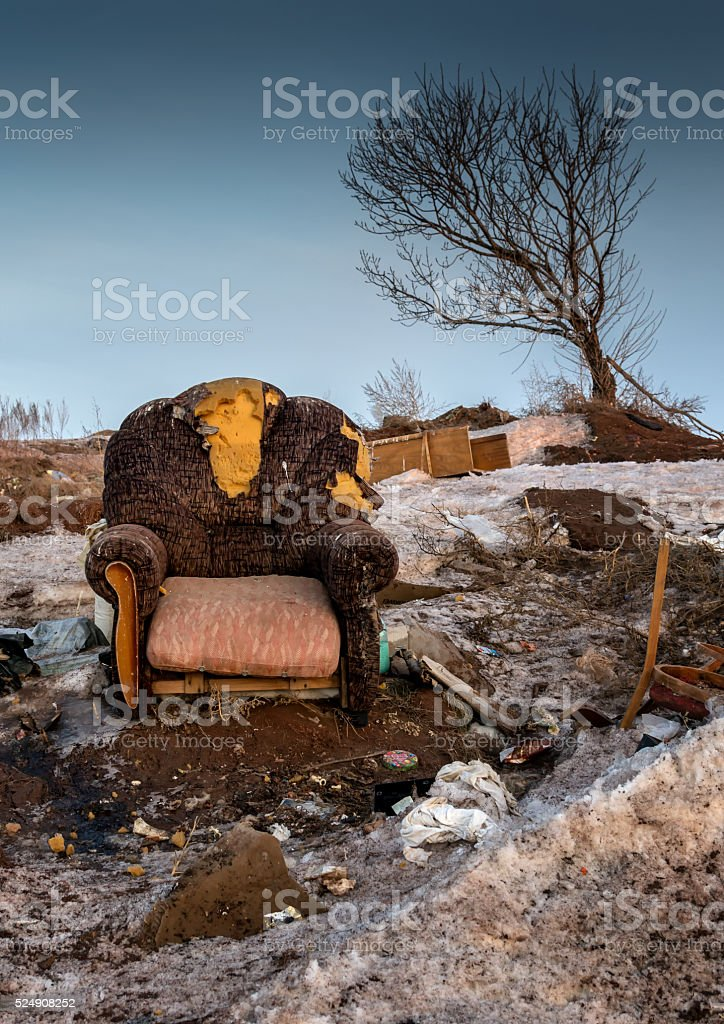 Abandoned Armchair and Leaning Tree Colour stock photo