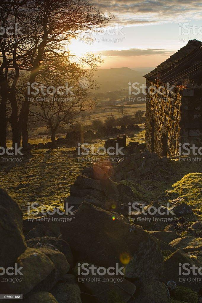 Abandoned barn at sunset stock photo