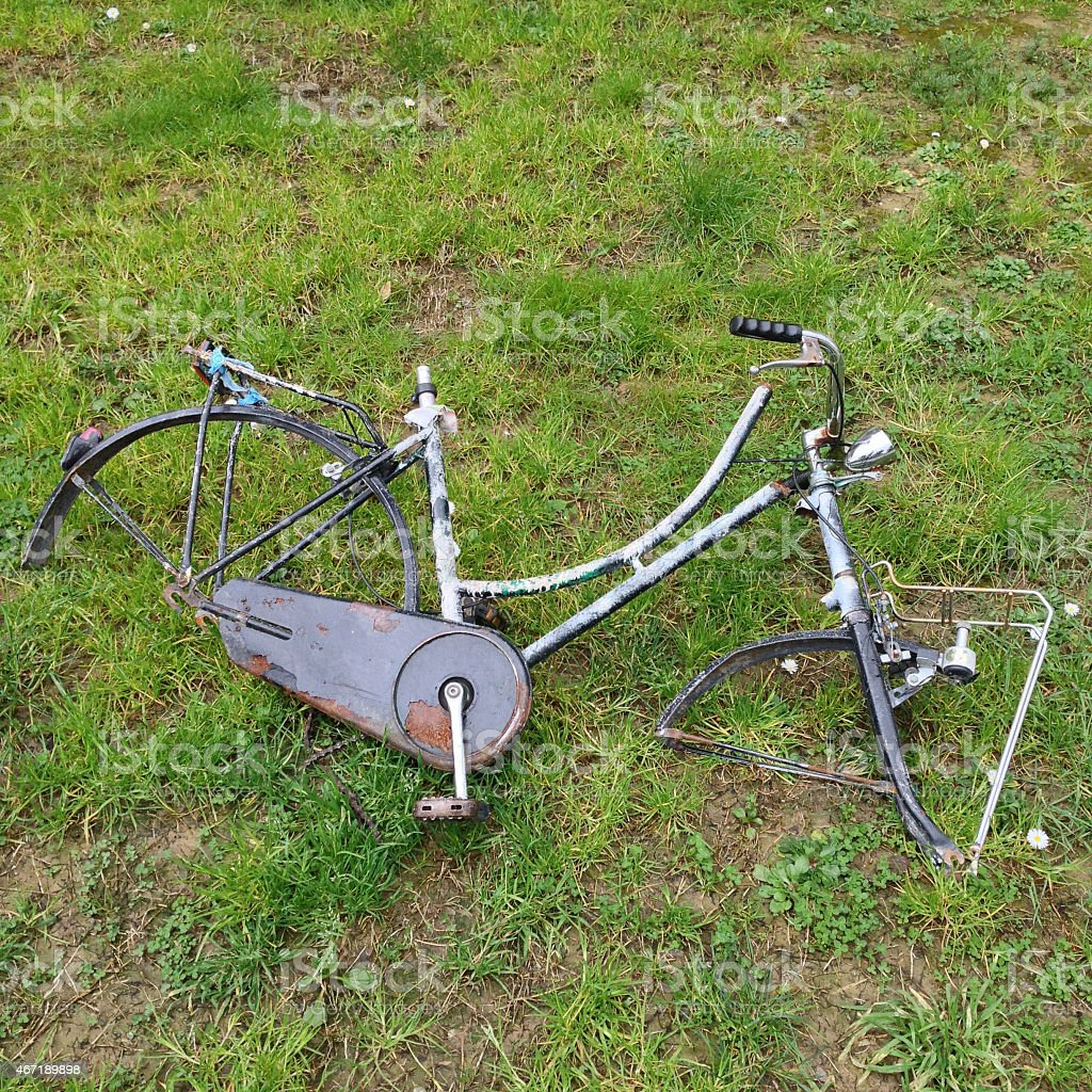 Abandoned bicycle on the grass stock photo