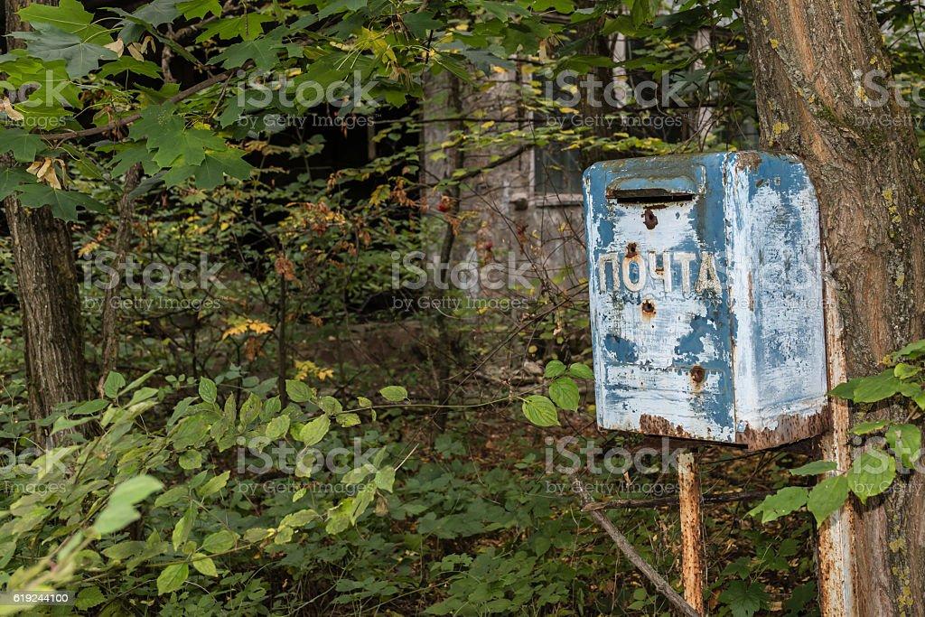 Abandoned blue mailbox,Chernobyl. stock photo