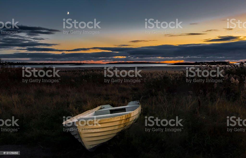 Abandoned boat under sunset light stock photo