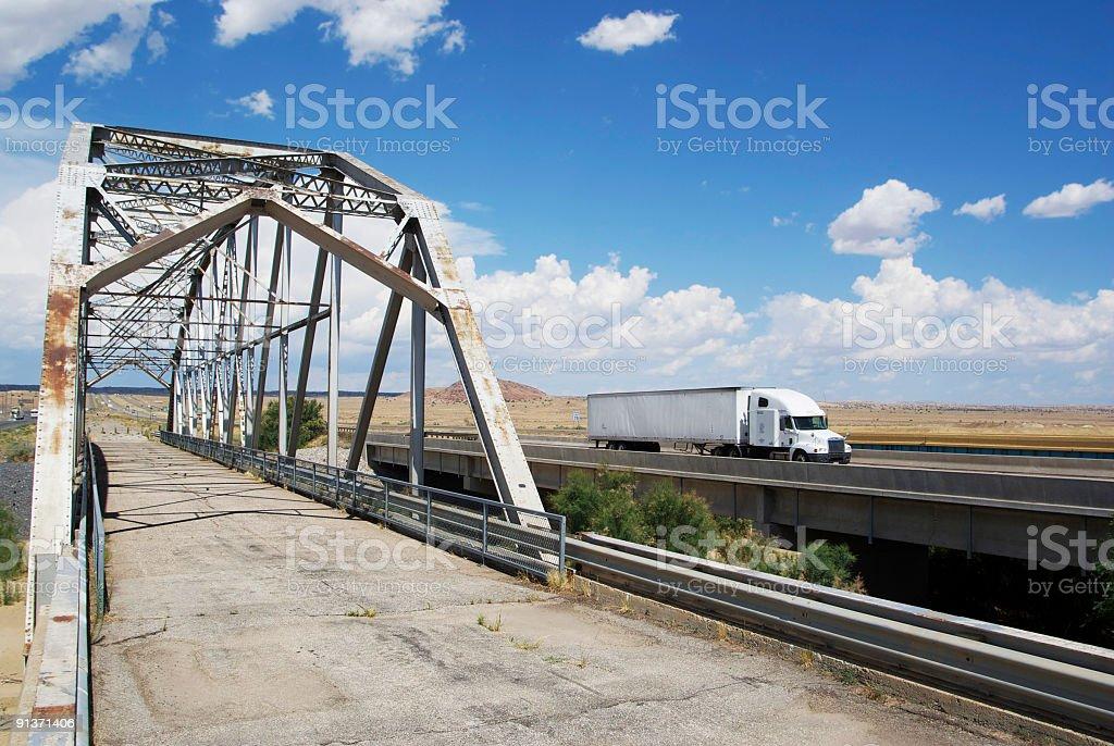 abandoned bridge paralleling interstate freeway royalty-free stock photo