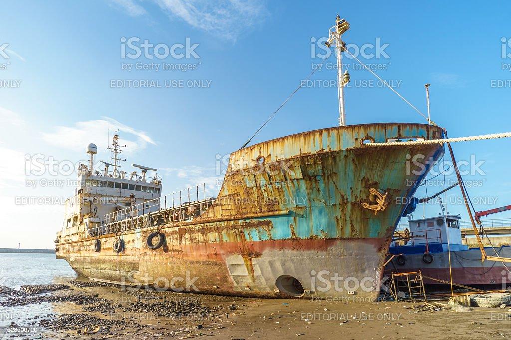 Abandoned broken ship stock photo