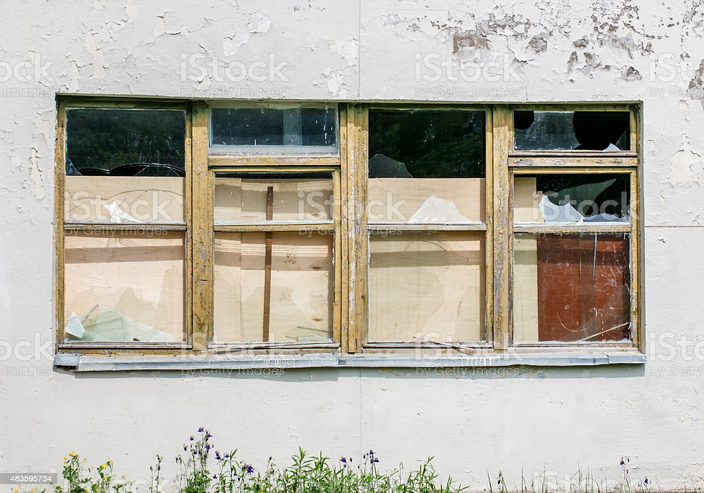 Abandoned broken windows front view stock photo