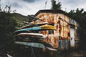 Abandoned building and old canoe
