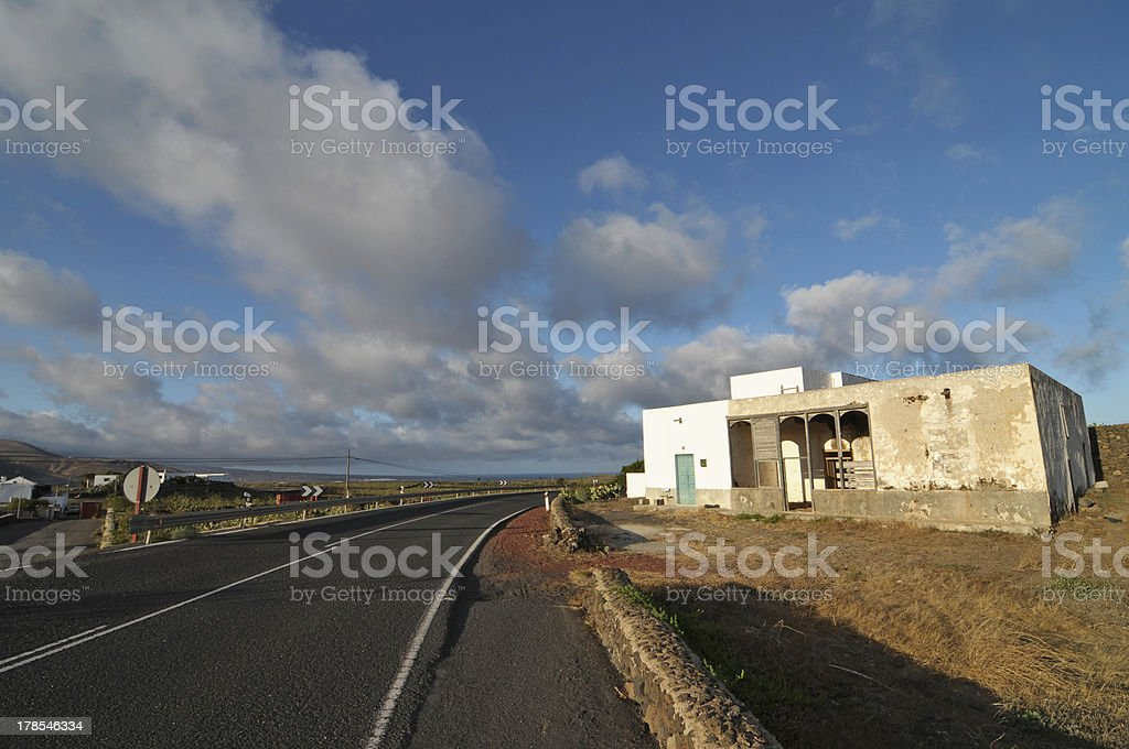 Abandoned building in the desert on a cloudy sky royalty-free stock photo