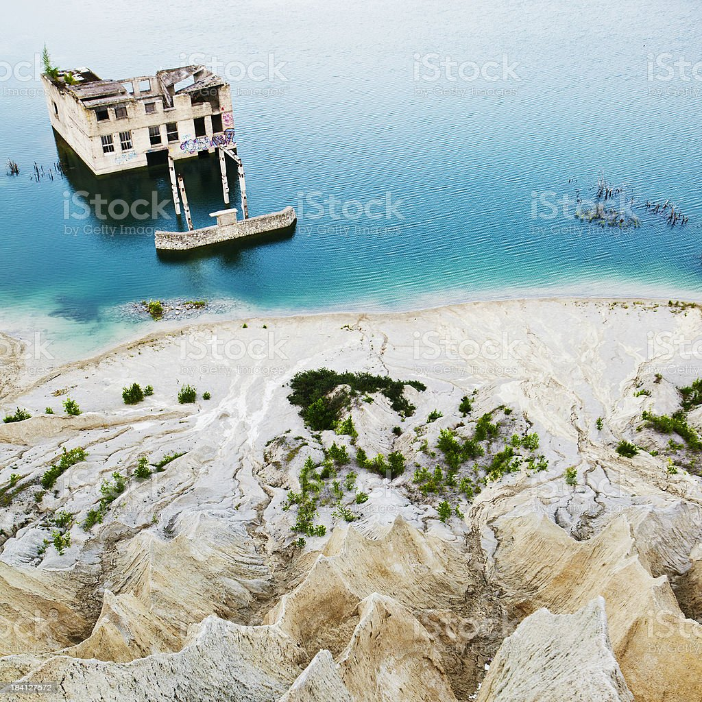 abandoned building in the middle of water stock photo