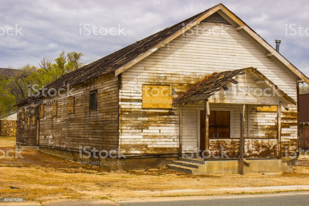 Abandoned Building With Boarded Up Windows stock photo