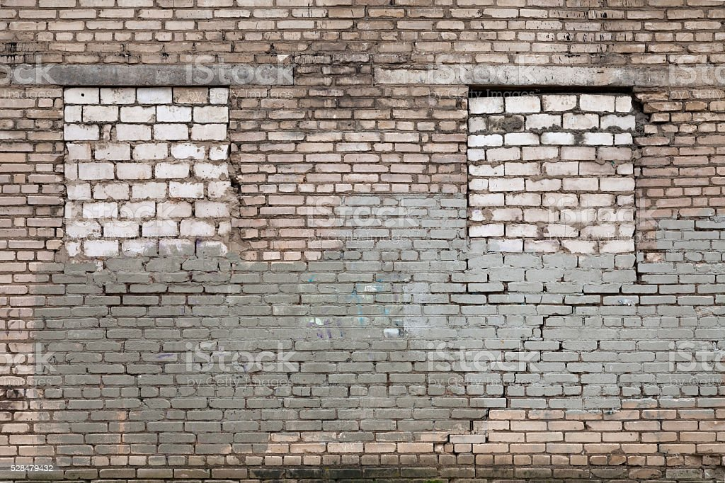 Abandoned building with bricked up windows stock photo