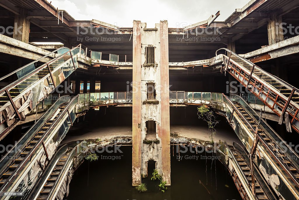Abandoned building with escalators stock photo