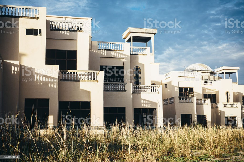 Abandoned buildings with yellow glass stock photo