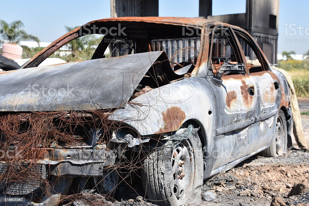 Abandoned Burnt Car stock photo