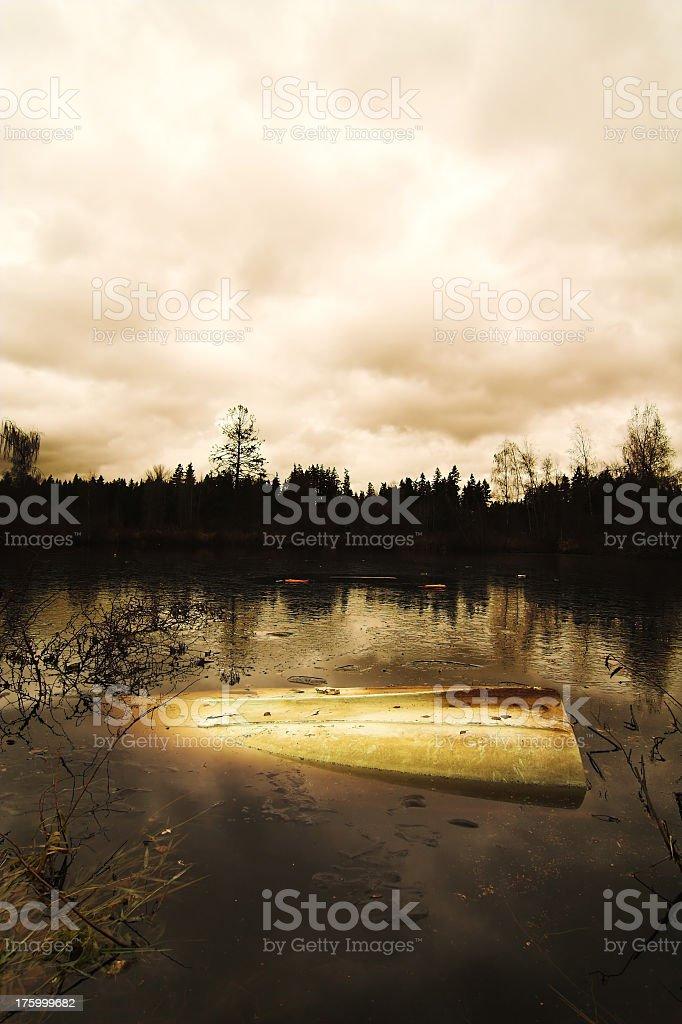 Abandoned Capsized Boat stock photo