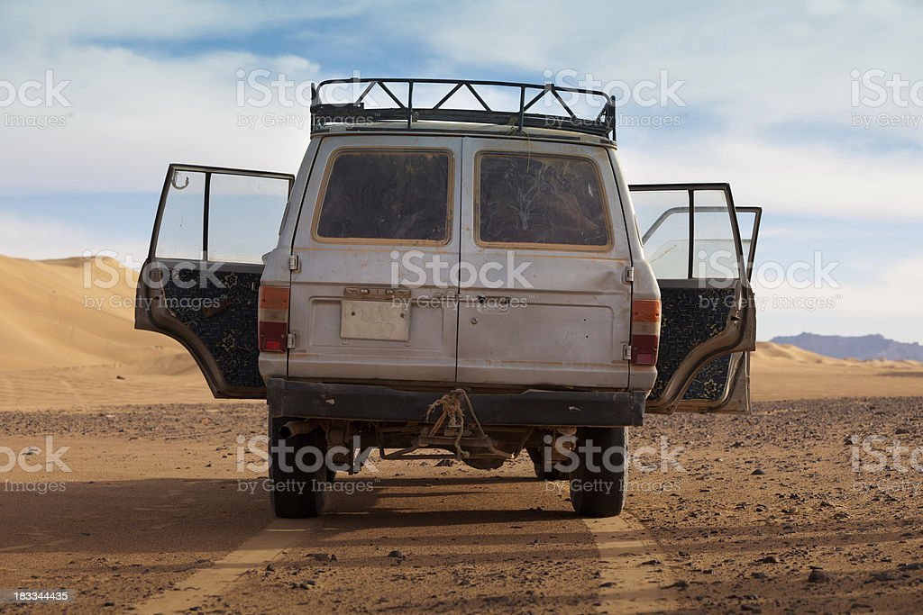 Abandoned car in Libyan desert royalty-free stock photo