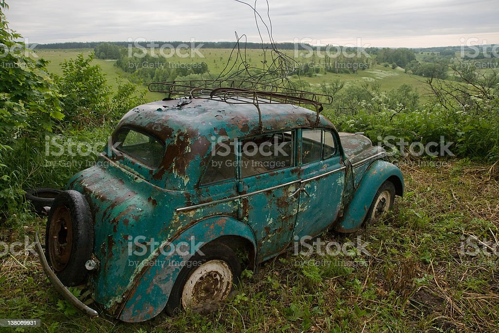 Abandoned car in the back-country royalty-free stock photo