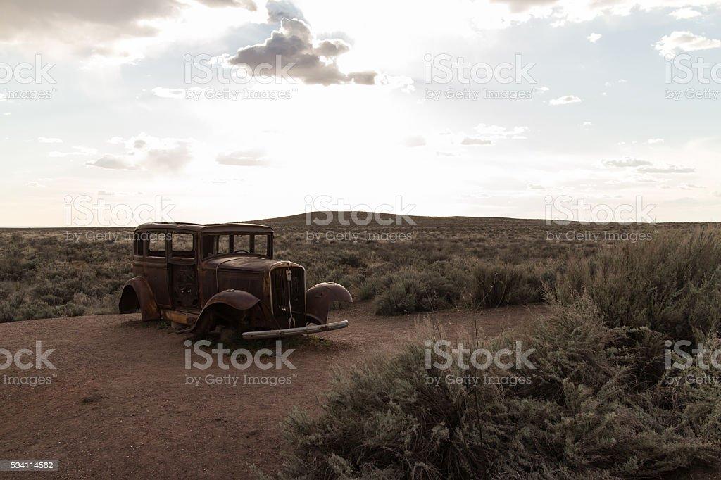 Abandoned Car in the Desert stock photo