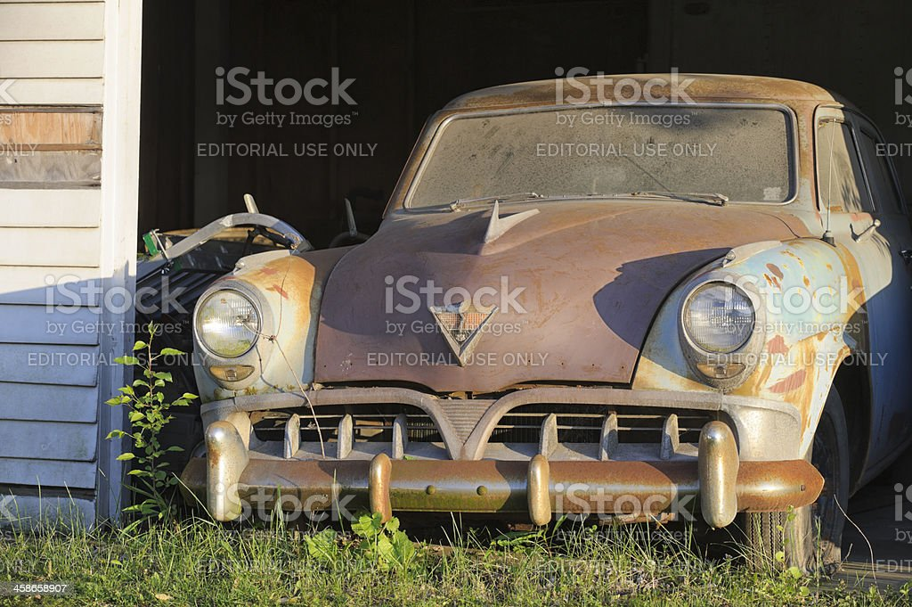 Abandoned Car Rusty and Dirty, 1950's Studebaker in a Garage stock photo