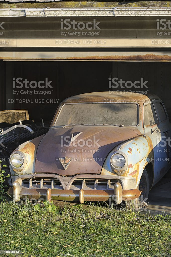 Abandoned Car Rusty and Dirty, 1950's Studebaker in Old Garage stock photo